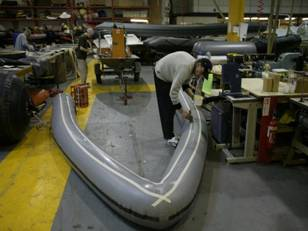 Preparing new tube for fitting to hull